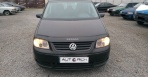 Volkswagen Touran 1.9 TDI AT (105 л.с.)